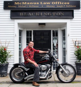 Motorcycle accident attorney Joseph P. McManus on his motorcycle in front of his Massachusetts law office.