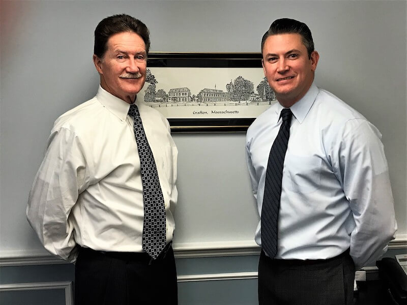 Massachusetts divorce and family law attorneys Michael and Joseph McManus standing together.